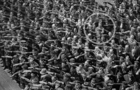 A-lone-man-refusing-to-do-the-Nazi-salute-1936